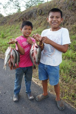 Kids selling fish along the Panamerican Highway