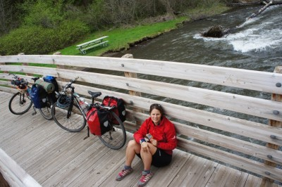 A snack break by the river during the decent from the pass