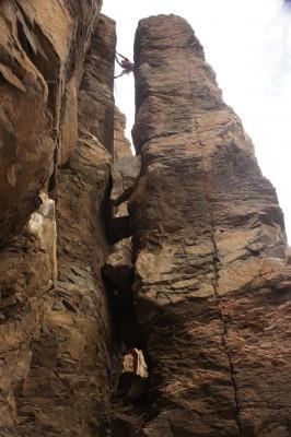 Myself, climbing up some sort of a split pillar