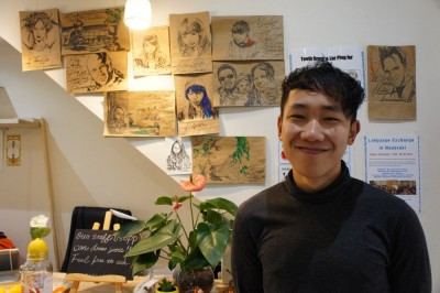 Kim, with his drawings, Casa Blanca Hostel